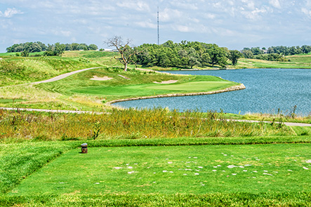 Hole 17 preview image shows the hole nestled along a large body of water surrounded by natural looking landscaping.